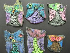 """El Sol Art: Clay Owls...1st grade students folded clay circles into wings and heads and pinched owl """"horns.""""  Folded and pinched circles were kiln fired after using tempuras."""
