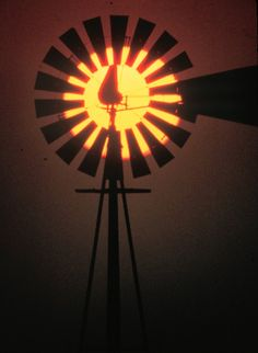 A windmill sunset. Near Houston, Texas. May Photographer: Blair Pittman.