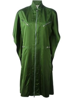 Green lightweight oversize coat from Jean Paul Gaultier featuring a stand up collar, a front zip fastening, short wide sleeves, front zipped pockets and a straight hem.