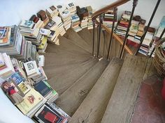i really REALLY love this! it's like the take-a-penny-leave-a-penny of book storage; pick a book up on your way upstairs, leave one on your way down