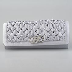 Silver Crinkled Satin Oblong Evening Clutch with Rhinestone On Sale:YESColor (Related):SilverCategory:Clutches/Shoulder BagsOccasion:Wedding/Special OccasionMaterial:SatinColor:Silver/GreyShown Color:SilverEmbellishment:Rhinestones/Crystal/RuchingOpen Method:Magnetic ClosureStrap or Handle Style:DetaDetachable ChainMeasurement…
