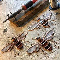 I've cut six bees today, and these three are ready to solder. (Shop link in bio :) #wip #copperfoil #soldering #stainedglass #bees #suncatcher #madetoorder #etsyshop #etsyseller #kellkraft