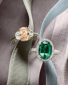 Oval-cut stones: a pink diamond and emerald
