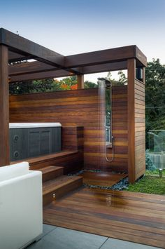 Outdoor shower and jacuzzi. Lovely wooden structure.