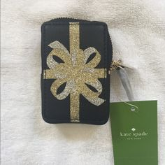 """Kate Spade Present Coin Purse Designed as a well wrapped present. Soft smooth cow hide with matching trim. Zip around closure, back reads """"you deserve it"""", Kate Spade N Y Charm. 1.4""""H 1""""W. New with tags. kate spade Bags"""