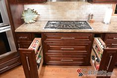 Spice pull out racks beside the range makes cooking a little easier! Cabinets shown are Jasper RTA Hampton Maple Mahogany.