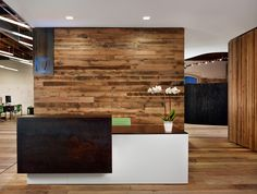 Floating reception desk amid open office layout - Peddle Office [Alterstudio and…