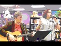 """See YouTube video of Janet Kuypers with John Yotko on guitar 3/15/18 in their 1-hour 45-minute """"South-by Set"""" of music at Austin's """"Recycled Reads"""" (one of the venues hosting 2018 SXSW events in Austin). In this set, she covered """"Kodachrome"""", """"the Bottom Line"""" (joined w/ John vocals), her poem/John's song """"Made any Difference"""",""""Crazy Little Thing Called Love"""",""""Waiting"""", """"Devotion"""", """"Coming Back to You"""", and """"I am not a Pretty Girl"""" (cut off). (Panasonic Lumix T56 camera; Posterize filter)."""