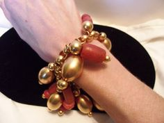 A personal favorite from my Etsy shop https://www.etsy.com/listing/241686947/egyptian-revival-charm-bracelet-gold