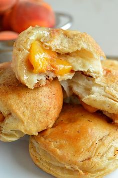 Peach Pie Biscuit Bombs - this recipe is so easy and SOOOO dang delicious! Dessert, breakfast, brunch!