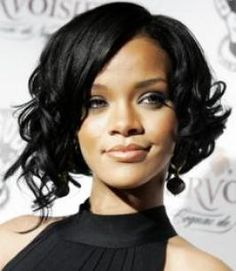 Curly asymmetrical bob.  Looking for more like this.