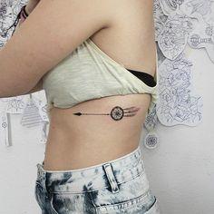 Dream catcher and arrow tattoo.