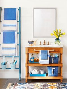 Use a cool vintage or upcycled ladder to bring vertical storage into many rooms in your home! Free up space in the bathroom by hanging towels on a painted ladder or use a step stool as a DIY bookcase or nightstand!