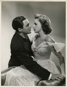 Gene Kelly and Judy Garland, 1940s. Look at how she looks at him.
