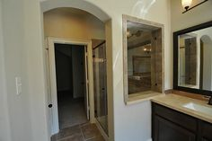 Huge Walk In Shower with surrounding with Upgrade Tile! and Travertine Stone, with Sitting Bench!  Upgrade Tile Floors, Upgrade Light Fixtures, Upgrade Tile Backsplash surrounding the Vanities and more!