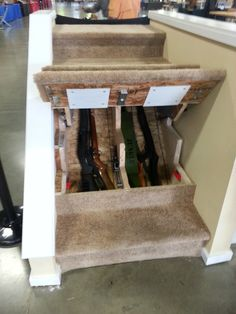 awesome gun storage in the stairs... keep it locked until you need them.