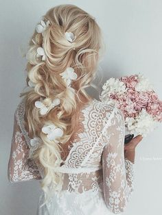 Blonde wedding hairstyle with white flower accessories and soft curls bridal hair #bride #wedding #hair