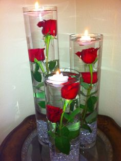 I love submerged arrangements! flowers, leaves...add in some candles and decorative rocks = pretty!