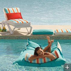 frontgate ......also a floating drink caddy for 59.50.. I would so fall asleep on this floatin around the pool.