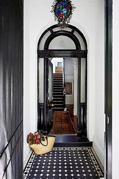 Open the front door of this renovated Victorian terrace and you'll find a runner in the entrance hall made in India. The light is from Morocco. Hall Tiles, Building A Porch, Melbourne Apartment, House With Porch, Home, Entrance, House Front, Victorian Terrace House, Entrance Hallway