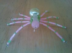 Pink and lime green beaded spider