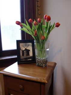 DIY - Images from an old calendar and fresh tulips in a vase with aquarium rocks.