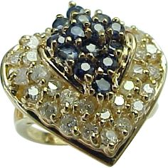 This ring showcases fourteen round blue sapphires that accented by 30 diamonds. Description from rubylane.com. I searched for this on bing.com/images