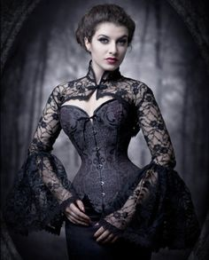 I need to make one of these awesome bell-sleeved high-necked lacey shrug things. Because this is awesome, that's why.