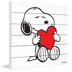 Description: Bold, in colors of black, white, and red, this Snoopy artwork features the beloved Peanuts character holding a heart. Printed on white wood, this art would work well in a Peanuts themed b