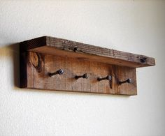 "Rustic key rack, key hanger, reclaimed wall hooks, 17"" x 4"" barn wood hanger with 4 pegs by TumbleweedCabin on Etsy https://www.etsy.com/listing/98200504/rustic-key-rack-key-hanger-reclaimed"