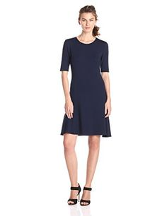 T Tahari Women's Briza Short Sleeve Fit and Flare Dress in Navy-nice sleeve length and scoop neckline LBD is LND! ,66% Modal, 29% Polyester, 5% Elastane. Machine Wash! Very light with a cute flare at the bottom