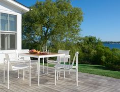 1966 Collection Dining Arm Chair by Richard Schultz is an outdoor dining chair that has been setting the scene for modern meals outdoors for over 50 years. The aluminum frame makes them resilient to weather and wind, while the signature mesh back keeps you cool | Knoll