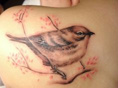 Songbird Tattoo - A songbird is related to sailors. A sailor would know he was close to land once he saw a sparrow flying. It means finding land and good luck.