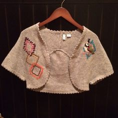 Anthropologie Wool Sweater NWOT! Moth for Anthropologie wool sweater shrug. This is too cute for words! Hand embroidery and sweet scallops outline entire sweater. Never worn, in excellent new condition! True to fit size small. No trades or PayPal. Anthropologie Sweaters