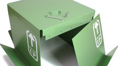 "The ""this side up"" table can be easily broken down into five pieces, enabling compact transport."