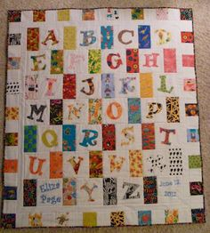 ABC Quilt, each strip of fabric is an image of the letter- A, apple fabric etc.