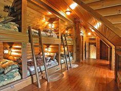 Wow!  Classic Smith Construction has topped all Designer Bunkrooms with this one!  Six Queen Size Bunks built into Log Walls!