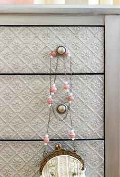 Use textured wallpaper on a dresser & then paint over it.