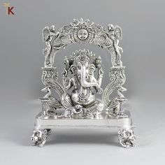 Sterling Silver Ganpati Silver Idol l Net Wt: gms Purity: NOTE: Prices do not reflect actual price of the product. Visit one of our stores for final price. Silver Cutlery, Silver Trays, Silver Pooja Items, Baby Ganesha, Ganapati Decoration, Ganesha Tattoo, Pooja Room Door Design, Silver Ornaments, Pooja Rooms