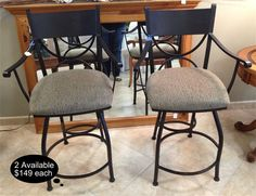 "These pair of iron bar stools measure 24"", have arms, and swivel. Heavy sturdy construction perfect streamline fit to any decor.    Yesterdays Treasures Consignment  5829 Lone Tree Way Suite J  Antioch, CA 94531  925.233.4547  www.Yesterdayststore.com  Info@yesterdayststore.com"