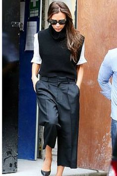sneakers and pearls, street style, tblack cullotes, vest over a white shirt, Victoria Beckham, trending now.png