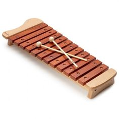 Beautiful wooden xylophone made with high-quality beech wood. This 12 keys model features - 8 x 1 inch bars presenting twelve precision-tuned notes in the diatonic scale from C to G. Diatonic Scale, Musical Toys, Kids Corner, Built In Storage, Holiday Gift Guide, Types Of Wood, Musical Instruments, Baby Toys, Kids Toys