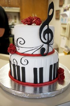 Music red white and black birthday cake. Handmade piano keys, treble cliff, hand painted music notes and hand made red roses. All edible.