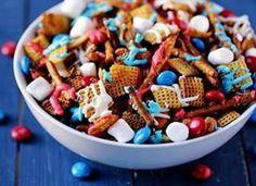 Red White & Blue Chex Mix -- traditional Chex mix goes a little sweeter and more colorful with this fun patriotic version! via @Ali Ebright (Gimme Some Oven)