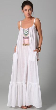 A cute little Boho vibe going on with this Embroidered Peasant Dress Stay cool for hot Summer...