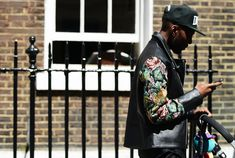 Flower Power. This guy looks to have a head start to the coming seasons with his look. Two trends in one piece: a biker jacket with floral sleeves.