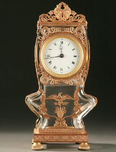 ENCH CUT CRYSTAL AND GILT BRONZE MOUNTED DESK CLOCK, mid 19th century, cut and polished flat panel crystal case with gilt bronze mounts of scrolling foliage and ribbon above an eagle. Height 10.5 inches.