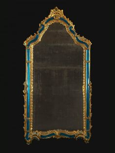 AN EXTRAORDINARY ROCOCO GILTWOOD AND TURQUOISE GLASS MOUNTED PIER MIRROR Venice 1750 H: 76 3/4″ (195 cm), W: 41″ (104 cm)