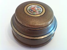My Aunt gave me a couple of these when I was a child. I've always loved them. Lador Lidded Vintage Musical Powder Box 1940s. $98.00, via Etsy.