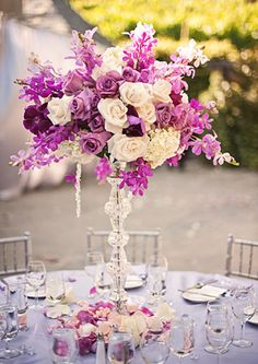 Table centerpieces included lavendar and cream colored roses, orchids and hydrangeas by GD Designers.